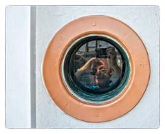 Man in a Porthole (Timothy Valentine) Tags: reflection window self wednesday boat us unitedstates massachusetts large gloucester gloucesterharbor 2015 0815