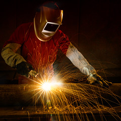 Welding (Krunja) Tags: man hot industry metal closeup fire construction iron industrial factory mask steel welding weld labor smoke duty working arc safety equipment flame repair metalwork workplace rod worker manual protective heavy laborer job spark protection tool flaming fill ironworks skill manufacture welder manufacturing skilled laboring