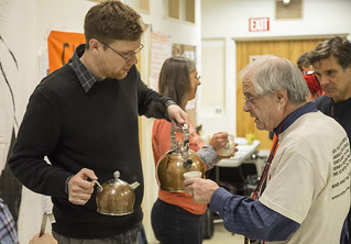 Aaron Hughes Serves Tea to Members of Witness Against Torture During the Breaking of a Week-Long Fast