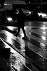 On the waterlogged road (pascalcolin1) Tags: paris13 placeditalie nuit night pluie rain reflets reflection femme woman cars voitures phares lights lumières photoderue streetview urbanarte noiretblanc blackandwhite photopascalcolin headlights