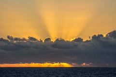 the world's best alarm clock (-gregg-) Tags: cruise ocean sunrise clouds rays