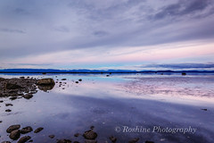 Shallow Water, Flat and Smooth (Roshine Photography) Tags: slowshutter eveninglight comox pointhomes salishsea environmental reflection sunset winter landscape cooltones calmwater lowtide rocks britishcolumbia canada ca