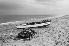 Waiting for next fishing (Kais Kraiem) Tags: winter sea net beach dark boat fishing sand waiting melancholy blackwhitephotos