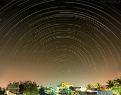 Star Trails from my house (AdityaGopal27) Tags: longexposure light india house home composition stars star asia long exposure earth sony curves trails kitlens astro stack astrophotography pollution astronomy hours remote alpha andhra rotating startrails manfrotto pradesh polaris longexpsoure maxstone rajahmundry polestar mirrorless sonyclick astroscape nex5 nex51855mm tempusnex astronex