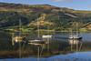 Boats at Glencoe (Kev Gregory (General)) Tags: looking shore loch leven glencoe scottish highlands harsh stunning mountain terrain north hint nearby ben nevis scotland most historic glen romantic filming harry potter film prisoner azkaban kev gregory boats reflection canon 7d