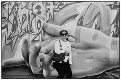 In the Palm of the Hand - Las Vegas, NV (gastwa) Tags: nikon fm3a 28mm f28 wide angle wideangle ais manual focus manualfocus film ilford hp5 plus black white blackandwhite bw art las vegas old downtown andrew gastwirth andrewgastwirth street urban graffiti portrait woman analog monochrome