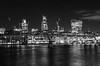 Thames by night (Spannarama) Tags: millenniumbridge bridge night dark evening longexposure thames river water london uk lights walkietalkie cheesegrater tower42 blackandwhite crane