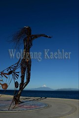 60072241 (wolfgangkaehler) Tags: 2016 southamerica southamerican latinamerica chile chilean southernchile town puertovaraschile view lakellanquihue lakedistrict osornovolcano lake mountain volcano waterfront art publicart sculpture sculptures metalart metalartwork metalsculpture metalsculptures woman