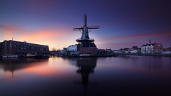 Fluweel (zsnajorrah) Tags: urban windmill water river reflection jetty boat transportation church bridge sky clouds twilight bluehour sunrise earlymorning wideangle ultrawideangle uwa neutreldensityfilter ndfilter nd x3nd10 longexposure concours 7dmarkii efs1018mm netherlands haarlem deadriaan adriaan spaarne koudenhorn bakenesserkerk catharijnebrug zuidam explore