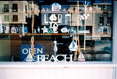 Open Beach (35mm) (jcbkk1956) Tags: shop seaside deal kent film rankmamiya mamiya mamiyasekor rangefinder analog 35mm souvenirs agfa200 reflection window