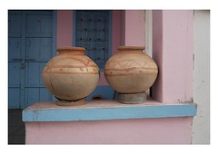 the potter's art (handheld-films) Tags: pink blue india house home exterior indian pots doorway rajasthan earthenware waterpots