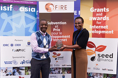 ISIF ASIA and FRIDA AWARDS 2012 .Ms. Anne Rachel Inné, FRIDA Chief Operations Officer, AFRINIC speakes to the audience and award winners watch the media presentation during the awards event. ..Event w