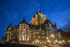 Chateau Frontenac (Irrational Photography) Tags: quebec city canada canon slr dslr 550d 5d mark iii digital photo picture lens brick wall wallpaper minimalism minimalist street hill road window bars metal graffiti worn down bar barred broken old used up side walk sidewalk red orange yellow pop motion blur walking mason masonry haute ville basse upper lower parliment brickwork architecture outdoor chateau frontenac hotel light night lights un irrational photography