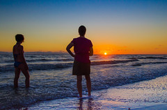 Last Light (Tom Fenske Photography) Tags: ocean sunset sea people woman sun beach gulfofmexico water girl silhouette swim evening coast sand florida bikini shore sanibel
