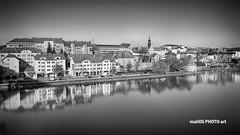 Maribor, city on the river Drava (malioli) Tags: city urban blackandwhite bw water monochrome canon river town europe place slovenia bnw maribor reflaction drava