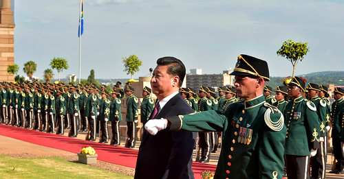 Chinese President Xi Jinping inspects the military guard of honour during his state visit to South Africa at the Union Buildings in Pretoria.