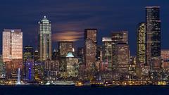 Peek-a-boo! (Brendinni) Tags: seattle skyline clouds buildings crane illumination pugetsound seattlewa columbiatower