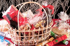Christmas charity hampers (jancamilleri) Tags: wrapped winebottle holiday celebration cracker goldcolored picnicbasket silvercolored wicker christmasornament giving santaclaus white red greencolor blackcolor paper woodmaterial closeup season gift decoration christmas traditionalfestival cake cookie chocolate candy sweetfood food alcohol basket boxcontainer bottle goodies yuletide ribbon bow