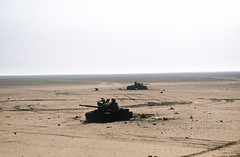Two destroyed Iraqi T-62 main battle tanks lie in the sand beside a road during the ground phase of Operation DESERT STORM. (k.aksoy93) Tags: t62 kwt iraqiarmy