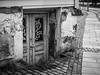 """Abandoned basement"" (Terje Helberg Photography) Tags: bw forfall abandoned basement blackandwhite bnw citylife cityscape citywalk cobbelstone decay door entrance grafitti leadinglines monochrome narrowstreet neglected old reflection street streetlife unattended urban urbex norway hordaland bergen"