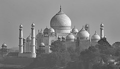 The Taj Mahal in Agra India through the mist. (Dave Russell (1.5 million views thanks)) Tags: building architecture history historic holy religion religious mausoleum agra india view vista scene scenery landscape black white monochrome minaret minarets dome marble tourism tour travel outdoor blackandwhite autofocus mist haze hazy uttar pradesh