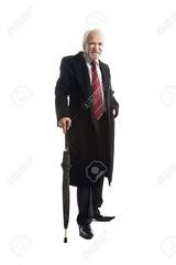 Elderly elegant man with  umbrella  gestures (levitanissac) Tags: cane confident copyspace fashionable gentleman gestures handsome jacket man elderly coat gray strict boss serious standing stick stylish successful suit business businessman smile thinking trendy umbrella walking