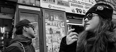 Different lives. (Baz 120) Tags: candid candidstreet candidportrait city candidface candidphotography contrast street streetphoto streetcandid streetphotography streetphotograph streetportrait rome roma romepeople romestreets romecandid europe women monochrome monotone mono blackandwhite bw noiretblanc urban voigtlandercolorskopar21mmf40 life leicam8 leica primelens portrait people unposed italy italia girl grittystreetphotography flashstreetphotography flash faces decisivemoment strangers