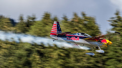 Kirby Chambliss in his Edge 540 V3 @ Spielberg (Thomas Ranner) Tags: trees sport race forest kirby track smoke edge panning propeller filming redbull 540 flyingbulls bo105 airrace redbullairrace chambliss zivko kirbychambliss 540v3