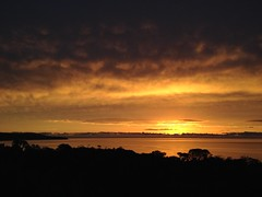 Angry clouds (alideniese) Tags: sunset sea sky seascape storm reflection water clouds port dark landscape golden bay australia melbourne phillip streaks