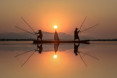 fisher X'men (SaravutWhanset) Tags: sunset summer people sun sunlight mist fish river asian photography photo fisherman asia twopeople reflextion