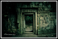Angkor Thom - the doorway to the royal garden (calamur) Tags: sculpture stone architecture cambodia arch buddhist arches doorway siemreap buddhisttemple angkorthom scul harinicalamur nikond7000