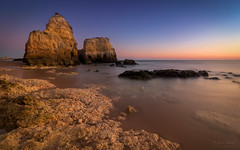 A Timeless Moment That Is Always New (Adam West (traveling)) Tags: adamwest algarve glow longexposure portugal timeless afterglow beach cliffs limestone rocks sand sea sunset rockpaper