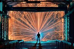Fighting the cold (palateth) Tags: lightpainting lightart night belgique belgie belgium nophotoshop singleexposure blue industrial urbex abandonnedplace fire fireworks katyusha