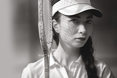 Emmy in tennis white (Yuri Figuenick) Tags: portrait woman girl tennis racket eyes face blackandwhite monochrome vintage retro oldschool japanese asian english british canon eos 5d markiii canon135mmf2l light shadow reflection strings