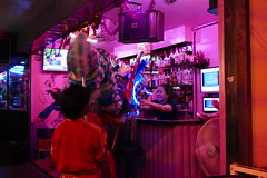 Bartender gives Dragon some money for New Year's good luck. (ashabot) Tags: lunarnewyear bangkok thailand bangkokstreetscene peopleoftheworld dragon night nightshots nightlights nightlife internationalcities travel seetheworld