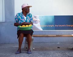 Bright future ? (dominiquesainthilaire) Tags: nikon people dominica westindies caribs caribbean island orange blue bleu île street rue fruit vendor vendeuse nikond80 roseau city old lady femme âgée thisphotorocks worldtrekker