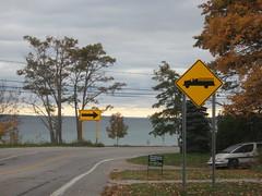 Signs along the road (yooperann) Tags: road autumn lake fall station sign yellow truck warning fire highway michigan entrance curve peninsula leelanau m22