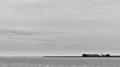 the hidden lighthouse (jaypchances) Tags: sky lighthouse lake holland netherlands dutch landscape grey skies cloudy widescreen horizon nederland windy shore marken