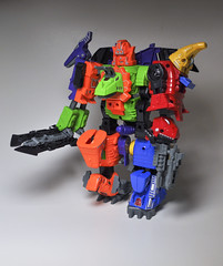 DinoKing in Repose (skipthefrogman) Tags: china city japan modern vintage toy japanese robot dino dinosaur transformer action slag review chinese off ko figure era g1 g2 import sludge bootleg swoop knock snarl scramble dinobot grimlock combiner