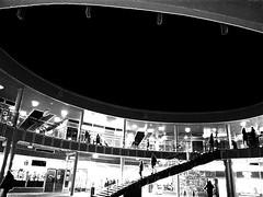 Dark sky, Helsinki, Finland, December 2016 (Juha Riissanen) Tags: helsinki finland processed silhouettes people bw stairs opening sky black contrast oval puotinharju puhos dark shopping lights
