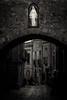 Mary and Neon (Jeff Damron) Tags: italysepia erice sicily street blackandwhite