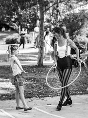 Conversation (Manny Esguerra) Tags: outdoors park bw hoop stripes