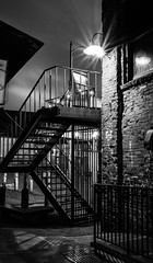 black iron stairs on windy cold night (FrankieJoseph) Tags: seattle night street blackandwhite pikeplace market wind sexy silky