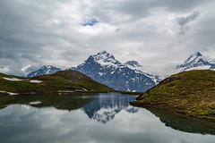 Bachalpsee (peaflockster) Tags: summer lake mountains reflection june clouds landscape switzerland serene glassy swissalps bachalpsee