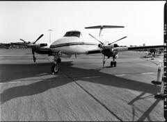 BeechCraft King Air (LarsHolte) Tags: pentax645 645 645n 6x45 smcpentaxfa 45mm f28 foma fomapan 400iso mediumformat film analog analogue blackandwhite classicblackwhite monochrome filmforever filmphotography d76 larsholte homeprocessing atl1500 autolab roskilde airshow denmark danmark beechcraft kingair bw jobo fomapan400 fomapan400action 120 ishootfilm pentax 120film