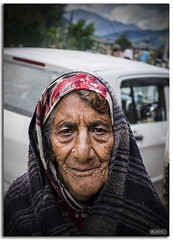 Portrait of a Senior Kashmiri Woman! (KS Photography!) Tags: poverty life street travel portrait people mountain color senior face vertical closeup mystery female rural dark real outdoors eyes village power looking adult skin serious grandmother market outdoor head indian homeless mother culture lifestyle content underprivileged human aged emotions sorrow wrinkles feelings kashmiri slums concepts expertise jammuandkashmir photoborder pahelgam