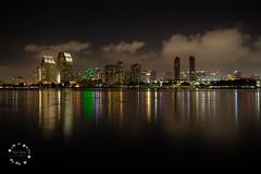 San Diego Skyline (lit t) Tags: california longexposure nightphotography reflection skyline clouds downtown sandiego sandiegoskyline canon60d terridoaktaylor