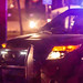 Minneapolis Police Department squad car shines spotlight on 4th Precinct demonstrators and clean up crews during early morning eviction, with visible dash camera