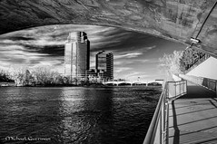 A Stroll Under the Bridge (Michael Guttman) Tags: bridge sky blackandwhite bw monochrome river blackwhite walk michigan grandrapids riverwalk topaz denoise grandrapidsriverwalk topazbweffects