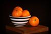 Clementine Still Life. (Through Serena's Lens) Tags: odc bowlfullof clementine fruit citrus ripe orange bowl strips blackwhite indoor stilllife woodenboard